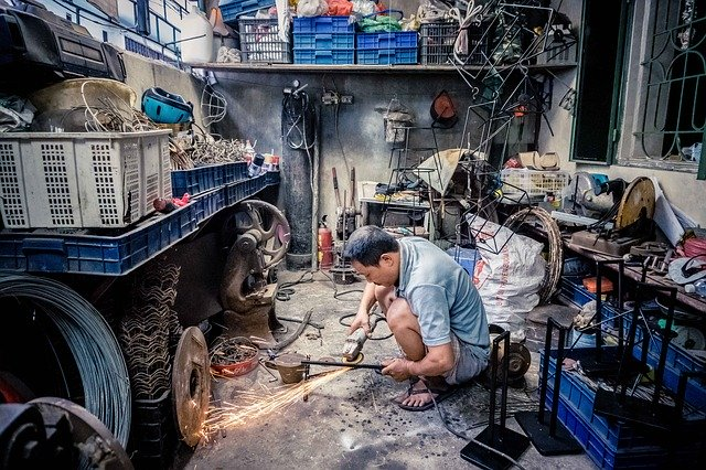 Worker using tools